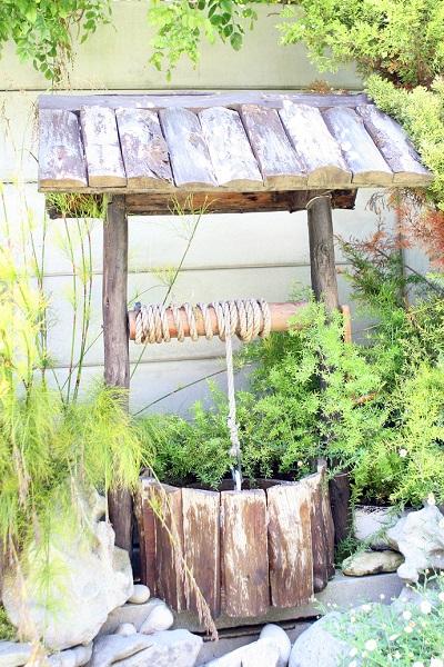 quaint summer garden wishing well for prosperity