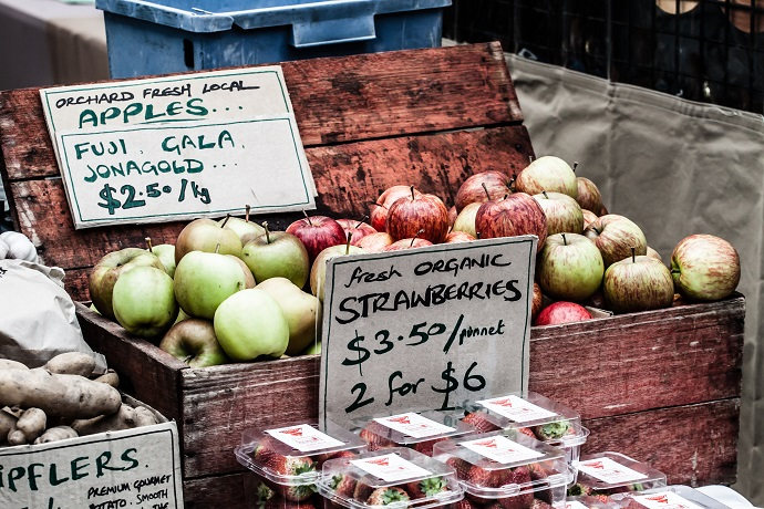 Fresh apples in baskets on display at a farmer's market