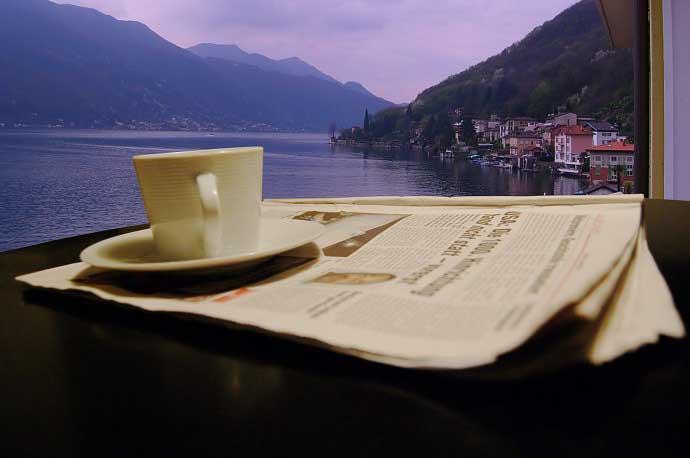 Morning Coffee newspaper over bay