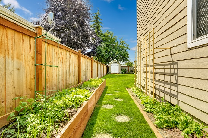 Fenced backyard with garden bed